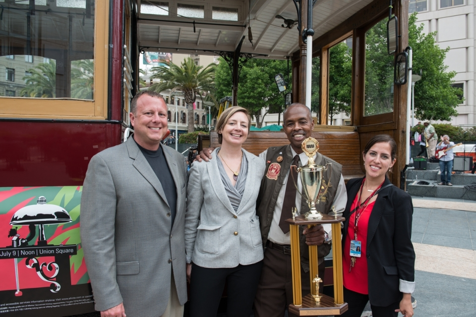 52nd Cable Car Bell Ringing Competition on July 9, 2015. R to L: Ed Cobean, Cable Car Sr. Operations Manager, Kristin Smith, Marketing Manager, Byron Cobb, bell ringing champ, Staci Morrison, Marketing Associate.